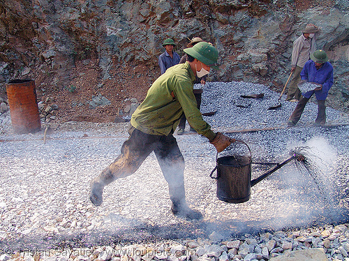 road paving - spraying hot asphalt over gravel with watering can - vietnam, gravel, groundwork, hot asphalt, hot bitumen, macadam, men, pavement, paving, petroleum, road construction, roadworks, smoke, smoking, spraying, watering can, workers, working