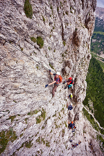 rock climbers on vertical cliff - via ferrata tridentina (dolomites), alps, cliff, climber, climbing harness, climbing helmet, dolomites, dolomiti, ferrata tridentina, mountain climbing, mountaineer, mountaineering, mountains, rock climbing, vertical, via ferrata brigata tridentina, woman