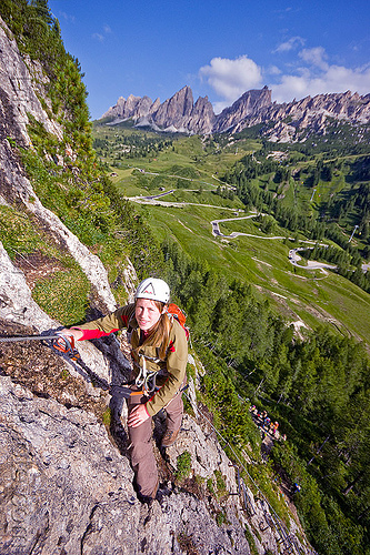 rock climbing in the dolomites - via ferrata tridentina, alps, cliff, climber, climbing harness, climbing helmet, dolomiti, mountain climbing, mountaineer, mountaineering, mountains, people, vertical, via ferrata brigata tridentina, woman