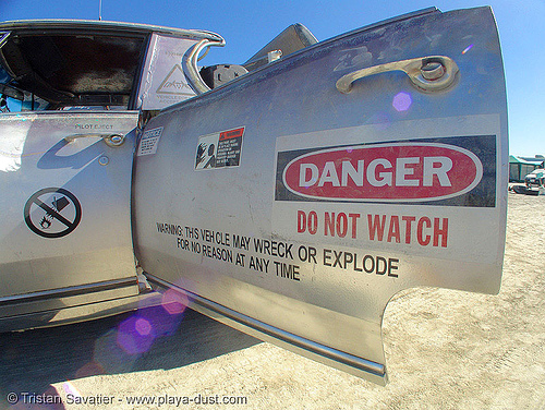 rocket car - burning-man 2005, art car, burning man, danger, hazard, rocket car, safety sign, warning