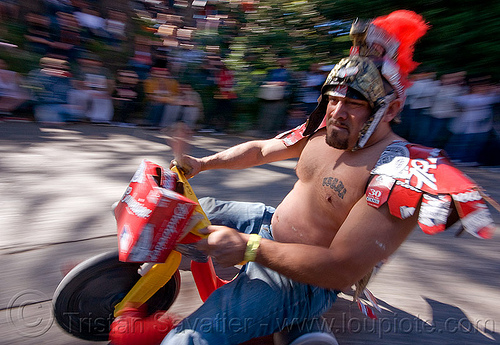 "roman gladiator - BYOBW - ""bring your own big wheel"" race - toy tricycles (san francisco), big wheel, byobw 2011, drift trikes, gladiator costume, moving fast, potrero hill, race, roman costume, speed, speeding, toy tricycle, toy trike, trike-drifting"