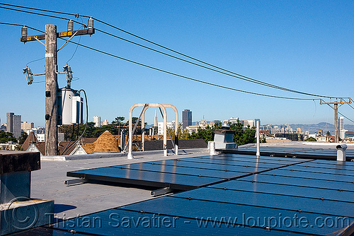 rooftop solar panels and power lines, electrical lines, electrical transformer, electricity, photovoltaic array, power lines, rooftop, solar array, solar energy, solar panels