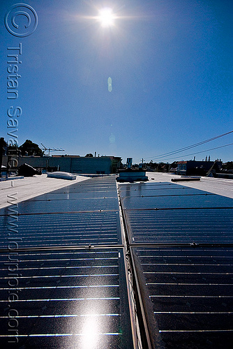 rooftop solar panels - sun, electricity, lens flare, photovoltaic array, power, rooftop, solar array, solar energy, solar panels, sun