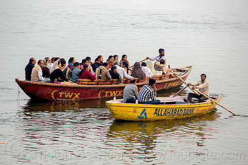 row boats sailing on ganges river (india), advertising, allahabad bank, ganga river, ganges river, painted, people, river boats, rowing boats, sailing, small boats, travel world experiences, two, twx, varanasi, water