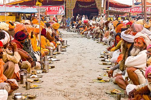 rows of hindu pilgrims eating holy prasad - kumbh mela 2013 (india), ashram, crowd, dinner, eating, food, hindu pilgrimage, hinduism, holy prasad, india, maha kumbh mela, men, pilgrims, rows, sitting