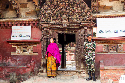 royal palace gate guarded by nepali soldier - bhaktapur durbar square (nepal), battledress, bhaktapur, durbar square, gate, guard, hinduism, intricate, man, military fatigues, nepalese army, soldier, standing, uniform, woman, wood carving, wooden