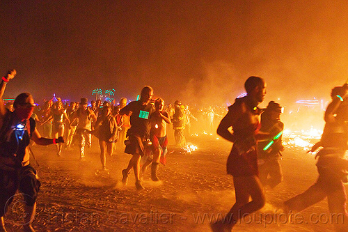 running melee around the man's burn - burning man 2013, burning man, celebrating, crowd, dust, embers, fire, glowing, melee, mêlée, night, running, smoke