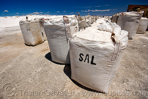 sacks of rock salt - rock salt mining in salinas grandes (jujuy, argentina), argentina, blue sky, bulk, exploitation, halite, industrial bags, jujuy, noroeste argentino, rock salt, sacks, sal, salar, salinas grandes, salt bags, salt bed, salt flats, salt lake, salt mine, salt mining, white