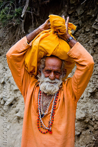 sadhu (hindu holy man) carrying bag on head - amarnath yatra (pilgrimage) - kashmir, amarnath yatra, baba, bhagwa, carrying on the head, hiking, hindu holy man, hindu pilgrimage, hinduism, india, kashmir, mountain trail, mountains, old man, pilgrim, sadhu, saffron color, trekking, white beard