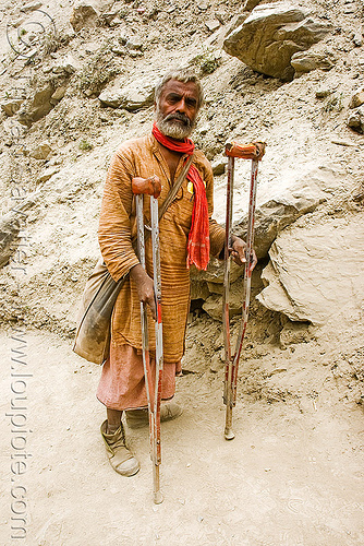 sadhu (hindu holy man) - crippled - crutches - amarnath yatra (pilgrimage) - kashmir, amarnath yatra, baba, beard, crippled, crutches, hindu holy man, hinduism, kashmir, mountain trail, mountains, old man, pilgrim, pilgrimage, sadhu, trekking, yatris, अमरनाथ गुफा