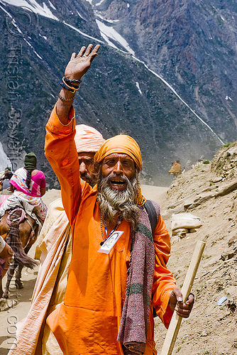 sadhu (hindu holy man) on trail - amarnath yatra (pilgrimage) - kashmir, amarnath yatra, baba, bhagwa, hiking, hindu holy man, hindu pilgrimage, hinduism, india, kashmir, mountain trail, mountains, pilgrim, sadhu, saffron color, trekking