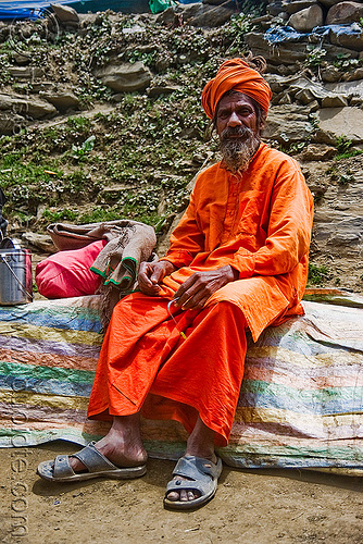 sadhu (hindu holy man) resting on trail - amarnath yatra (pilgrimage) - amarnath yatra (pilgrimage) - kashmir, amarnath yatra, baba, beard, bhagwa, hiking, hindu holy man, hindu pilgrimage, hinduism, india, kashmir, mountain trail, mountains, old man, pilgrim, resting, sadhu, saffron color, trekking