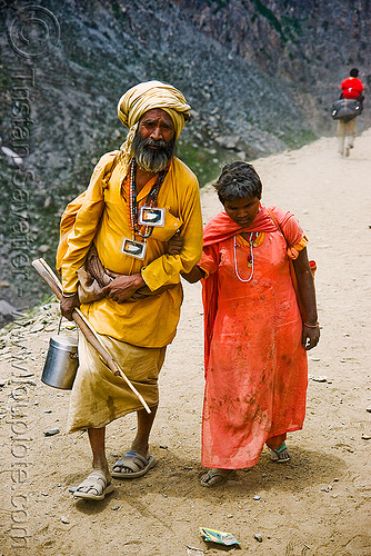 sadhu (hindu holy man) with blind woman on trail - amarnath yatra (pilgrimage) - kashmir, amarnath yatra, baba, beard, bhagwa, hiking, hindu holy man, hindu pilgrimage, hinduism, india, kashmir, mountain trail, mountains, old man, pilgrims, sadhu, saffron color, trekking