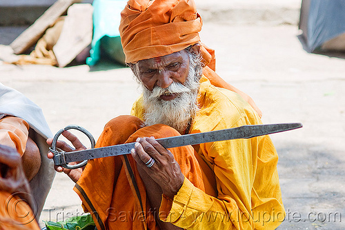 sadhu (hindu holy man) with chimpta - orchha (india), baba, bhagwa, chimpta, chimta, fire tong, hindu holy man, hinduism, india, musical instrument, old man, orchha, percussion, sadhu, saffron color, white beard