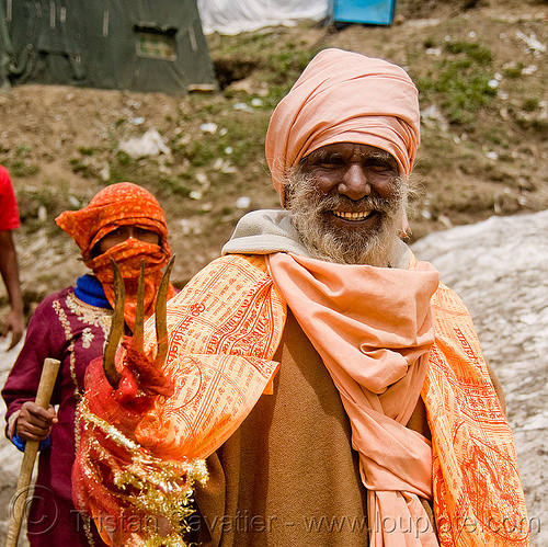 sadhu (hindu holy man) with trident - amarnath yatra (pilgrimage) - kashmir, amarnath yatra, baba, beard, bhagwa, hiking, hindu holy man, hindu pilgrimage, hinduism, india, kashmir, mountain trail, mountains, old man, pilgrim, sadhu, saffron color, trekking, trident