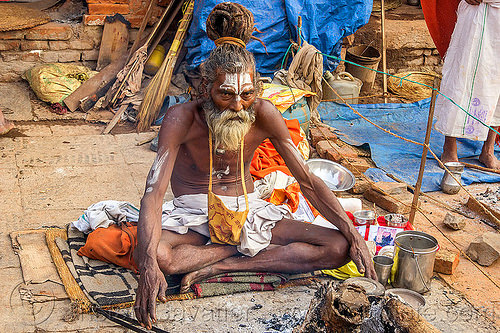 sadhu sitting cross-legged with threatening eyes (nepal), baba, beard, bonfire, cross-legged, dreads, festival, hindu, hinduism, kathmandu, knotted hair, maha shivaratri, man, pashupati, pashupatinath, sadhu, sitting, tilak, tilaka