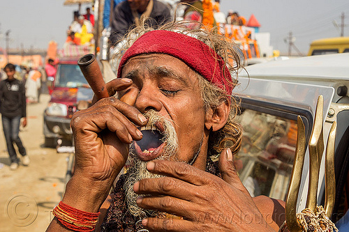 sadhu smoking ganja chillum - kumbh mela (india), baba, beard, cannabis, chillum, hindu, hinduism, kumba mela, kumbh maha snan, kumbha mela, maha kumbh mela, man, marijuana, mauni amavasya, sadhu, smoking, trident