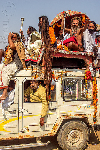sadhu with very long dreadlocks - kumbh mela (india), baba, beard, car, dreadlocks, float, gurus, hindu pilgrimage, hinduism, india, jeep, kumbh maha snan, maha kumbh mela, mauni amavasya, men, parade, sadhu, umbrella