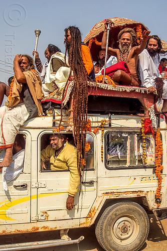 sadhu with very long dreadlocks - kumbh mela (india), baba, beard, car, dreads, float, gurus, hindu, hinduism, jeep, kumba mela, kumbh maha snan, kumbha mela, maha kumbh mela, mauni amavasya, men, parade, sadhu, umbrella