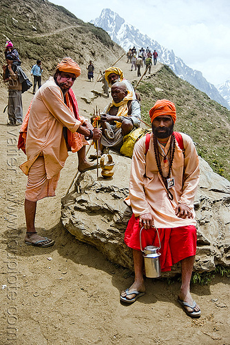 sadhus (hindu holy men) resting on trail - amarnath yatra (pilgrimage) - kashmir, amarnath yatra, babas, hiking, hindu holy men, hindu pilgrimage, hinduism, india, kashmir, man, mountain trail, mountains, pilgrims, resting, sadhus, trekking