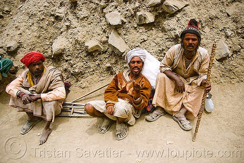 sadhus (hindu holy men) resting on the trail - amarnath yatra (pilgrimage) - kashmir, amarnath yatra, babas, beard, cane, crutches, hiking, hindu holy man, hindu pilgrimage, hinduism, india, kashmir, mountain trail, mountains, old men, pilgrims, resting, sadhus, trekking, walking stick