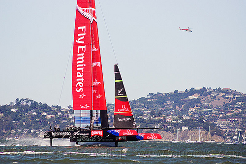 sailing hydrofoil catamaran emirates team new zealand - america's cup 2013 race (san francisco), ac72, advertising, america's cup, bay, boat, catamaran, emirates team new zealand, fast, foiling, helicopter, hydrofoil catamarans, hydrofoiling, race, racing, sailboat, sailing hydrofoils, ship, speed, sponsors