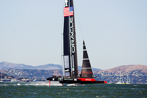 sailing hydrofoil catamaran oracle team USA - america's cup 2013 race (san francisco), ac72, advertising, america's cup, bay, boat, catamaran, fast, foiling, hydrofoil catamarans, hydrofoiling, oracle team usa, race, racing, sailboat, sailing hydrofoils, ship, speed, sponsors