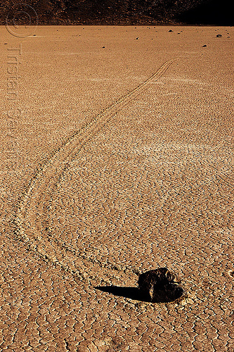 sailing stone curved track on the racetrack - death valley, cracked mud, death valley, desert, dry lake, dry mud, moving rock, racetrack playa, sailing stone, sliding rock, track