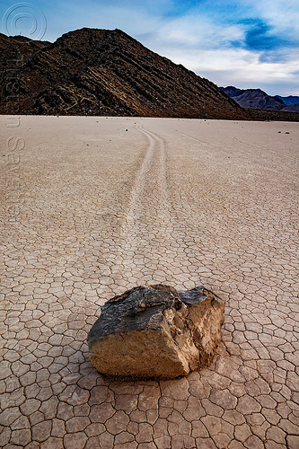 sailing stone on the racetrack - death valley, cracked mud, death valley, desert, dry lake, dry mud, mountains, racetrack playa, sailing stones, sliding rocks, tracks