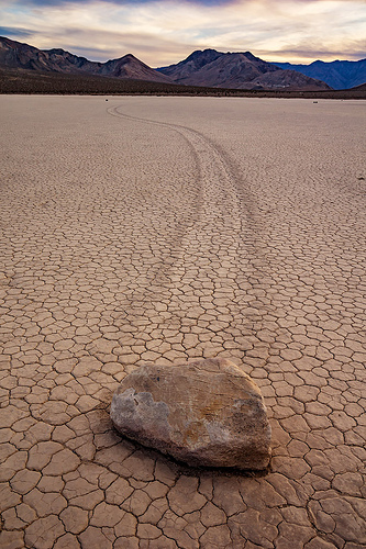 sailing stone on the racetrack - death valley, cracked mud, death valley, dry lake, dry mud, mountains, racetrack playa, sailing stones, sliding rocks