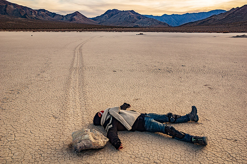 sailing stone on the racetrack - death valley, cracked mud, death valley, desert, dry lake, dry mud, mountains, racetrack playa, sailing stones, sliding rocks, tracks, woman