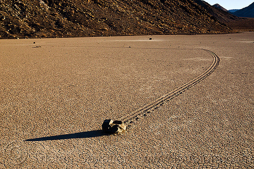 sailing stone on the racetrack - death valley, cracked mud, death valley, desert, dry lake, dry mud, mountains, racetrack playa, sailing stone, sliding rock, track