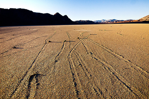sailing stones on the racetrack - death valley, cracked mud, death valley, desert, dry lake, dry mud, mountains, moving rocks, racetrack playa, sailing stones, sliding rocks, tracks