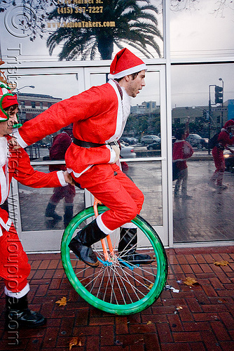 santa on unicycle - santacon 2009 - santa claus convention (san francisco), christmas, costume, green, man, red, santa claus, santacon, santarchy, santas, the triple crown, unicycle