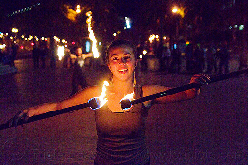 savanna spinning double fire staff, double staff, fire dancer, fire dancing, fire performer, fire spinning, fire staffs, flames, night, savanna, staves, woman