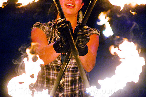 savanna spinning fire staffs, crossed, double staff, fire dancer, fire dancing, fire performer, fire spinning, fire staffs, fire staves, flame, leather gloves, night, savanna, spinning fire, woman