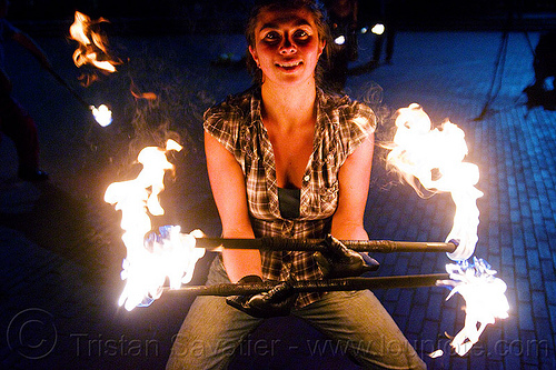 savanna spinning fire staffs, double staff, fire dancer, fire dancing, fire performer, fire spinning, fire staffs, fire staves, leather gloves, night, savanna, spinning fire, woman