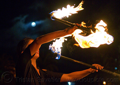 savanna spinning fire staves under the full moon, double staff, fire dancer, fire dancing, fire performer, fire spinning, fire staffs, fire staves, full moon, night, savanna, spinning fire, woman