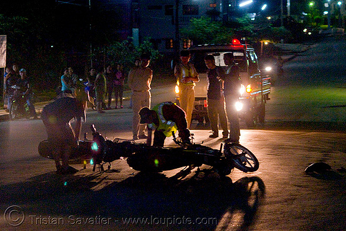 scooter accident - police (laos), backlight, collision, law enforcement, lying down, motorbikes, motorcycle accident, motorcycles, night, police, road crash, sam nua, scooter accident, street, traffic accident, traffic crash, xam nua