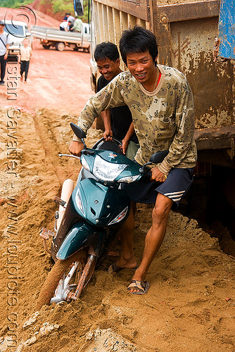scooter and truck stuck in mud (laos), laos, lorry, mud, rider, riding, road, ruts, truck, underbone motorcycle