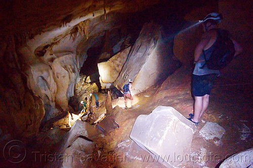 scrambling around big blocks - clearwater cave - mulu (borneo), blocks, cavers, caving, clearwater cave system, clearwater connection, gunung mulu national park, knotted rope, natural cave, roland, spelunkers, spelunking
