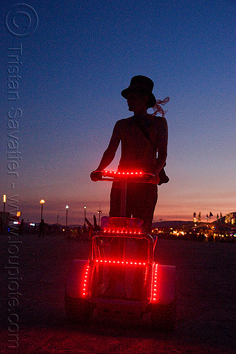 segway at dusk - burning man 2009, art car, burning man, hat, night, red, segway x2