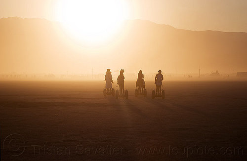 segways - burning man 2012, backlight, burning man, haze, hazy, segway x2, segways, shadows, silhouettes
