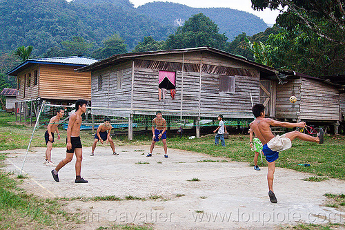 sepak takraw match, ball game, borneo, field, gunung mulu national park, kick volleyball, malaysia, men, net, panan, penan people, player, playing, rattan ball, sepak raga, sepak takraw, sport