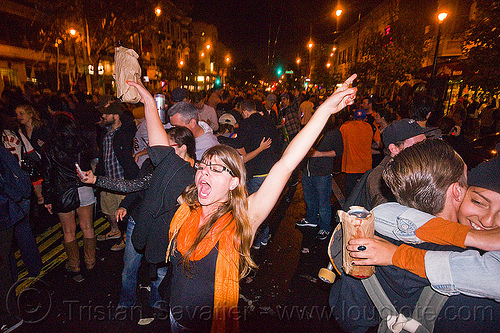 SF giants fans celebrating, 2012 world series, alcohol, baseball fans, beer, celebrating, crowd, editorial, go giants, night, paper bags, partying, sf giants, sports fans, street party, woman