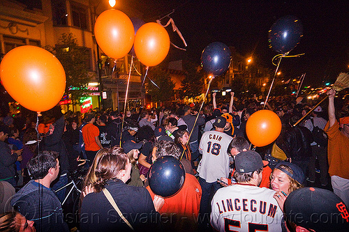 SF giants fans celebrating, 2012 world series, balloons, baseball fans, celebrating, crowd, editorial, go giants, night, partying, sf giants, sports fans, street party