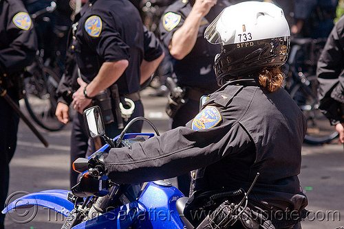 SFPD motorcycle riot police at the bay to breakers (san francisco), bay to breakers, crack-down, law enforcement, motorcycle unit, rider, riding, riot police, sfpd, street party, uniform, woman