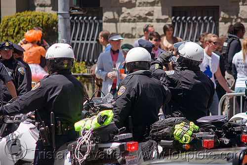 SFPD riot police on motorcycle at the bay to breakers (san francisco), bay to breakers, crack-down, festival, law enforcement, men, motorbikes, motorcycle unit, motorcycles, rider, riding, riot police, sfpd, street party, uniform