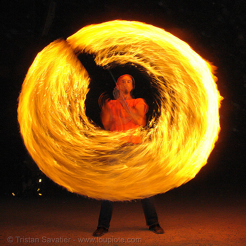 shanti (alex) spinning a fire staff (san francisco), circle, fire dancer, fire dancing, fire performer, fire spinning, fire staff, flame, long exposure, night, people, ring, spinning fire