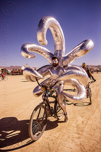 shiny inflatable costume with long arms - burning man 2015, beard, bicycle, bike, burning man, inflatable art, inflatable costume, mask, masked, riding, shiny, tentacles